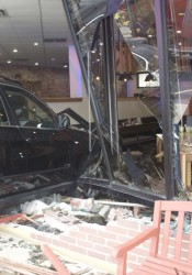 The BMW was embedded into the First Watch restaurant in Fairway Friday afternoon.