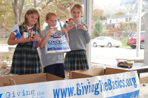 St. Ann students sort toiletries for Giving the Basics.
