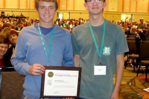 SM East students Tommy Shek and Joseph Cline show off the Harbinger's Pacemaker. Photo via KSPA.