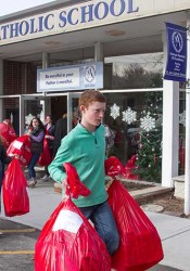 St. Ann students loaded up more than 130 red bags full of Christmas gifts for foster care kids and needy families.