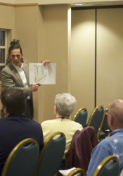 Developer Tom Valenti addressing questions about the Gateway project Tuesday.