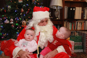 Santa making a last minute stop to visit twins Ella and Brenna Ross in Westwood on Christmas Eve.