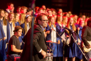 Ken Foley directing the choir at the awards show.