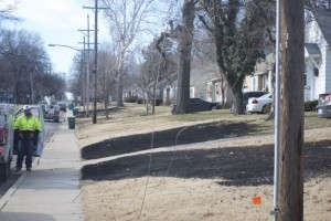 Yards along 51st Street were left blackened after dry grass caught on fire from downed power lines.