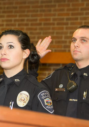 Officers Noelle Burns and Andrew Davidson take the oath at Monday's Prairie Village City Council meeting.