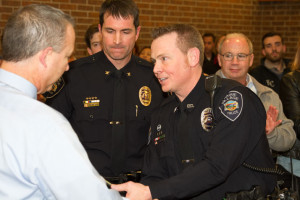 Officer Rick Bohon receives his Lifesaving Award.