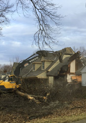 An excavator felled  the chimney of a Prairie Village Cape Cod on 74th Street Monday. The city has seen 58 tear downs since 2010.