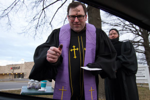"Colonial Church's Aaron Roberts braved the cold to deliver ""Drive By Ash Wednesday"" blessings."