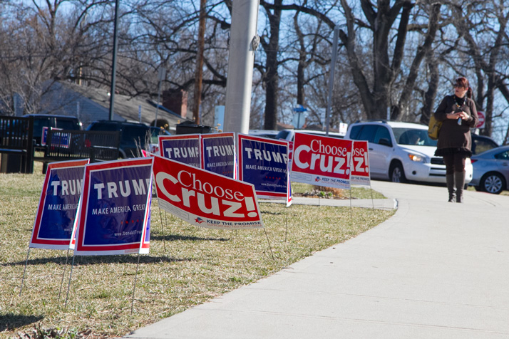 Signs for Donald Trump and Ted Cruz lined the sidewalk outside the SM East caucus site Saturday.