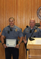 Mission Police Officer Chad Hodge (from left), Mission Police Officer Ryan Baylark, Mission Sgt. Tim Coffer and Olathe Officer Ian Mills.