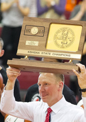 Athletic Director David Ewers hoisted the boys basketball title trophy to huge applause from the SM North faithful.
