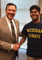 SM East principal John McKinney congratulated Bhavish Dinakar for his National Merit Scholarship. Photo via Twitter.