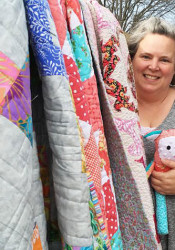 Amy Domke with some of her quilts. Photo courtesy Holly Dowell.