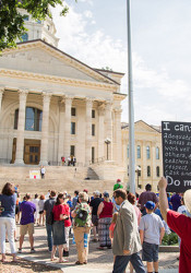 Pro-education funding reform protestors outside the capitol in June.