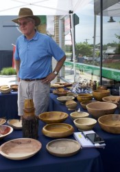 Carl Brooks showed his wooden bowl creations to a shopper Saturday on Johnson Drive.