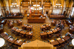 Legislators chat on the floor of the Kansas Senate.