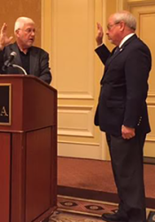 Past president Byron Ryder swears in Ron Shaffer as the new president of the NARC board.