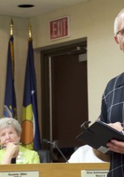 Paul Howe of Deffenbaugh Industries listened to a resident's complaint Wednesday at the Mission City Council meeting.