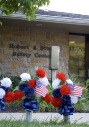 Flowers placed by residents in front of the Mission Police Department.