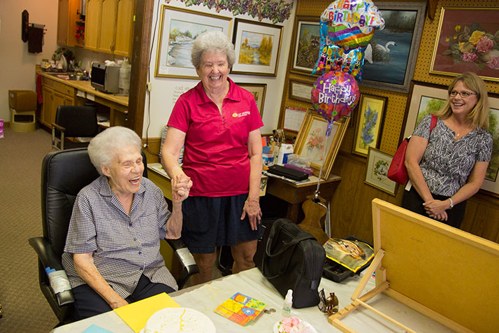 Betty Benson (left) and Suzie Gibbs of the Mission City Council share a laugh at the celebration for Benson's 95th birthday Wednesday.
