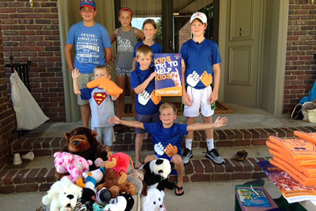 Kids held a sale of cookies, lemonade, sweet tea and stuffed animals in Prairie Village yesterday to benefit the Pinky Swear Foundation.