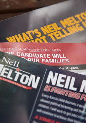 The mailers flooding District 21 mailboxes have painted conflicting pictures of candidates Dorothy Hughes and Neil Melton.