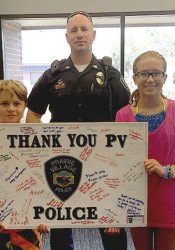 Michael and Audrey Gaillard dropped off their poster with the police July 22.