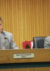 Mission Mayor Steve Schowengerdt and council member Tom Geraghty listen to residents speaking about the Gateway project at the city council meeting Wednesday.
