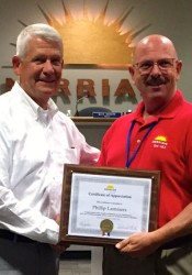 Phil Lammers (L) received a plaque of apprciation from Merriam Mayor Ken Sissom.
