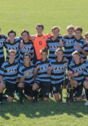 The SM East boys soccer team celebrates its tournament win. Photo by Carrie Armstrong