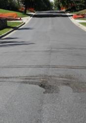 A driver damaged fresh asphalt on 63rd Street in Mission Hills.