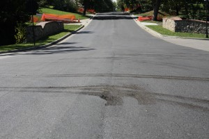 A driver damaged fresh asphalt on 63rd Street in Mission Hills.
