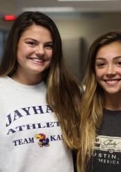 Emma Henderson (left), plays volleyball for SM East and Kalin Lamus is a gymnast.