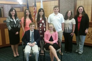 "Back row L-R Mayor Laura Wassmer, Zoe Renee Nason - Homeschool, Haoyang ""Helen"" Sun - Kansas City Christian Schools, Luke Hafner - St. James academy, Councilmembers Jori Nelson and Serena Schermoly; (front) Tyler Ruzich - Shawnee Mission North, Ainsley ""Scout"" Rice - Shawnee Mission East High School"