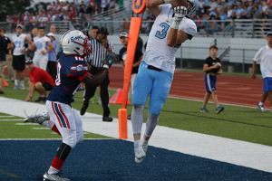 Trevor Thompson hauls in one of his three touchdown passes on the night. Photo by Tiffany Truster.