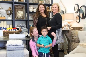 Megan Redmond and her son Finn are backed by Sara Dapp (left) and Jo Ann Dapp at their new store, Spinach Home.