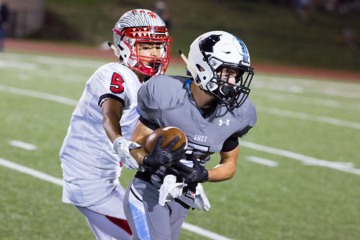Sky Tate hauled in a long pass to set up one of the Lancers five second-quarter touchdowns.