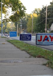 Communities in Northeast Johnson County are not lockstep in following a new state law on political yard signs.