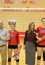 On Tuesday Bishop Miege volleyball senior manager Royal Shurm, left, setter Claira Creach, No. 3, and middle hitter Hannah Weber, No. 20, were honored before the Lady Stags match against Blue Valley West.