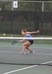 Senior Joie Beth Freirich volleys a ball during a doubles match against Blue Valley North on Wednesday. Freirich and Larkin McLiney fell 2-8.