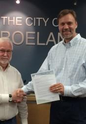 Ardie Davis (left) receives his proclamation from Roeland Park Mayor Joel Marquardt