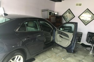 An elderly driver crashed her car Wednesday inside a hair salon at 5910 W. 59th Terr. in Mission. Photo courtesy Mission Police Department.