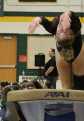 Shawnee Mission North's Alia Robertson completes her final vault on Saturday in state. Robertson also competed on the bars.