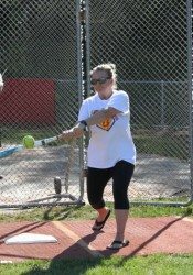 Carolyn Macan, Bo Macan's mother, connects on a softball during Bombs 4 Bo.