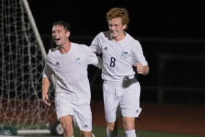 Grayson Rapp, left, and Tommy Nelson celebrate after the Lancers went up 1-0 against Blue Valley North Tuesday evening in their first playoff game. SM East next plays Blue Valley Northwest in the regional final at 7 p.m., Thursday at Shawnee Mission South District Stadium.