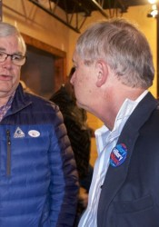 Jerry Stogsdill talks with former county commissioner Ed Peterson Tuesday night.
