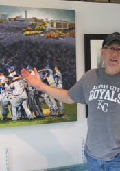 "Bill Rose and the ""Forever Royal"" mural commissioned by the team. It's now available in prints."