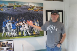 """Bill Rose and the """"Forever Royal"""" mural commissioned by the team. It's now available in prints."""