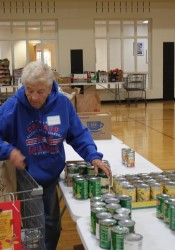 Ruth Higgins of Mission sorts canned goods going to a needy family for Thanksgiving.