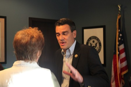 Rep. Kevin Yoder responds to a constituent during an open house at his Overland Park office.